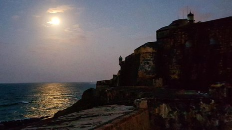 Moon reflecting in the Atlantic, with El Morro Fortification in the foreground