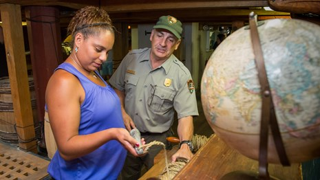 ranger talks to visitor about historic artifacts