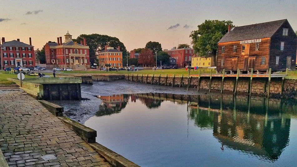 Color waterfront images with historic brick buildings in the background