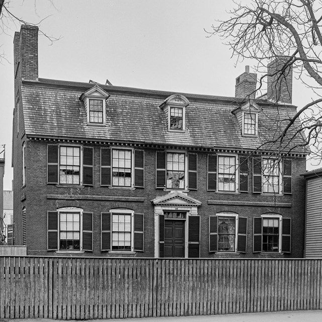 Black and white historic photo of the Derby House