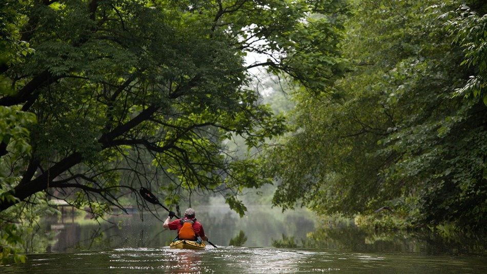 A kayak makes its way on the Schuylkill River