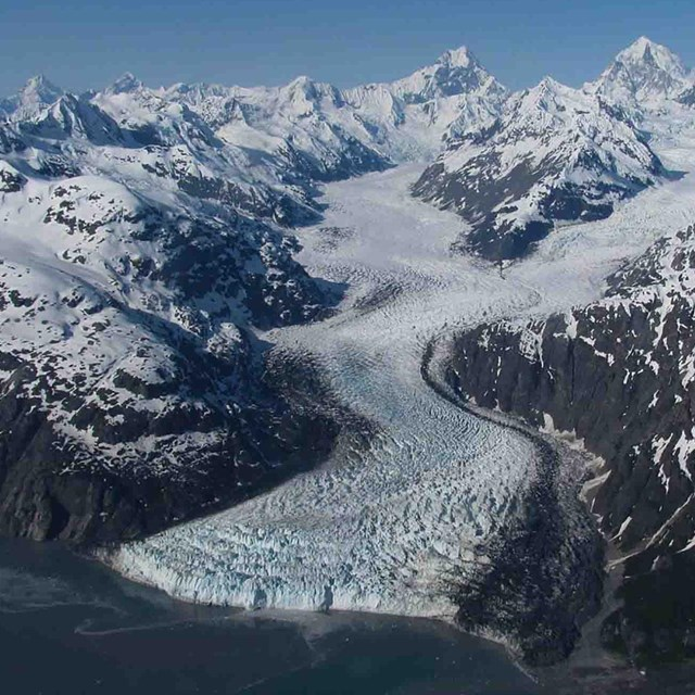 A tidewater glacier winds its way down the mountain in Glacier Bay.