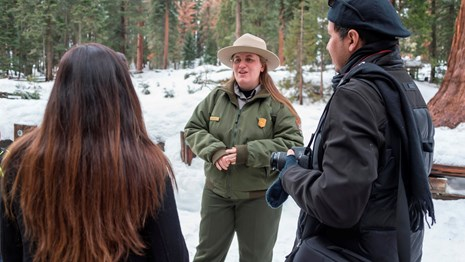 A ranger speaks with two visitors. Photo by Alison Taggart Barone