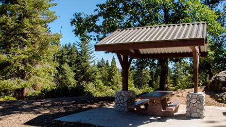 A picnic table with a shade structure. Photo by Alison Taggart-Barone.