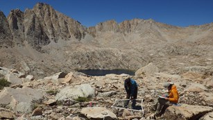 Two scientists record data at an alpine monitoring site near Mount Langley, Sequoia National Park.