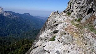 The High Sierra Trail winds along a granite cliff