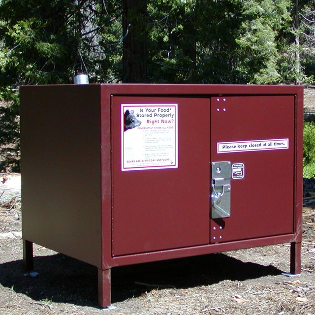 A metal food storage box is provided at each campsite.