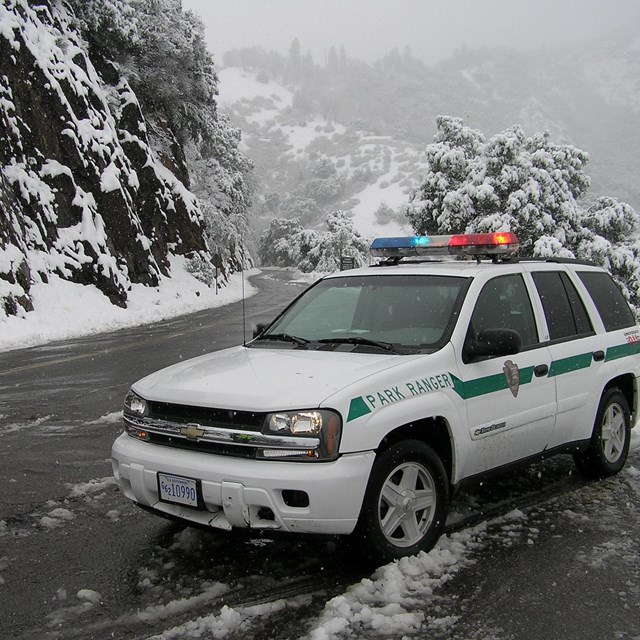 A patrol vehicle parked on a snowy road