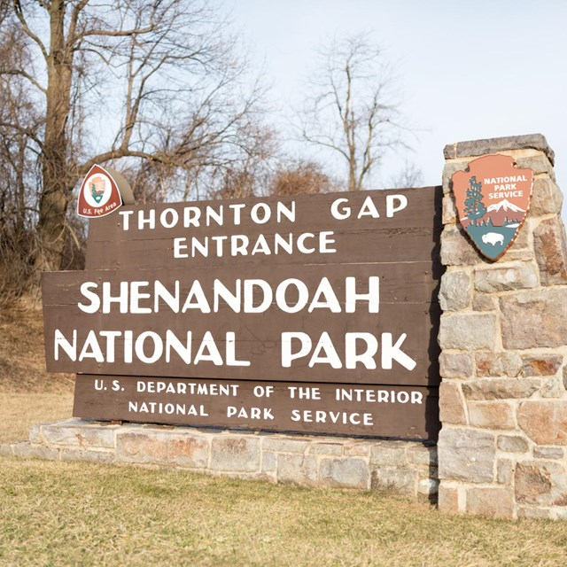 A large sign bordered by stone reads: Thornton Gap Entrance, Shenandoah National Park.