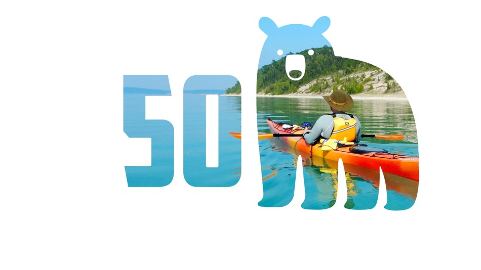 Bear outline with photo of kayaker inside