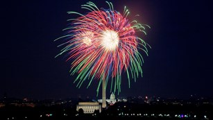 Fireworks explode in the sky over the National Mall in Washington D.C.