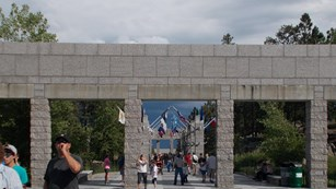 Visitors move through the promenande at Mount Rushmore National Park.