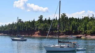 A sailboat anchors at Apostle Island National Seashore