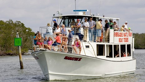 Visitors enjoy a boat tour in Everglades National Park