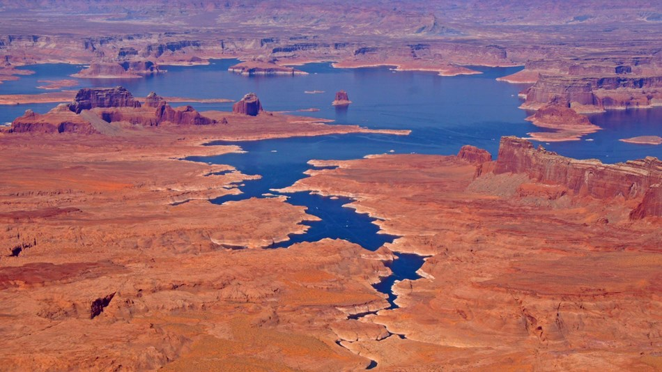 Aerial view of Lake Powell waterways and surrounding red rock buttes and land