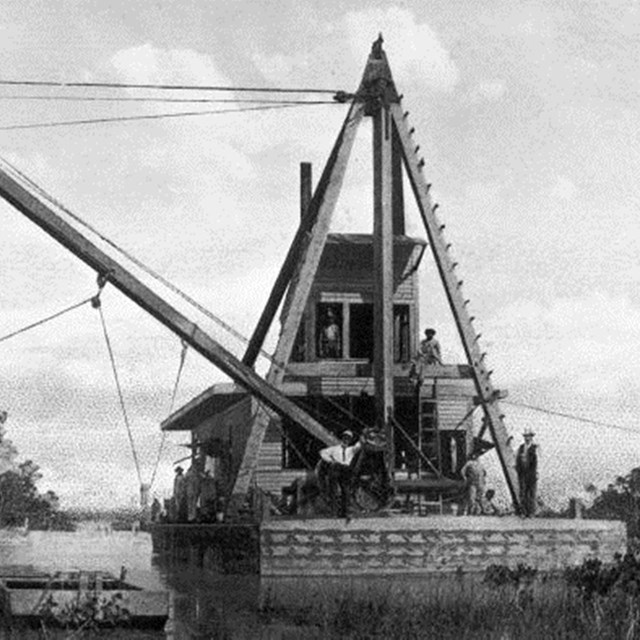 A bucket dredger photographed in the 1910s