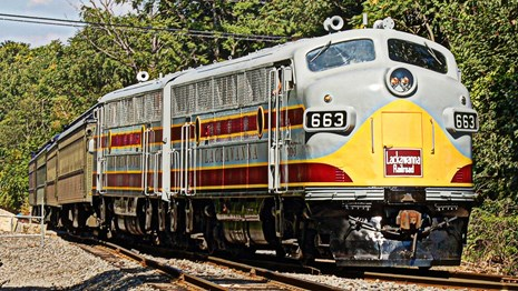 DLW-painted F3 diesel locomotive in gray, maroon and yellow colors