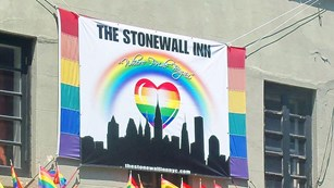 Exterior shot of the Stonewall Inn with a banner saying