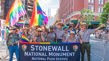 Park rangers participating in a pride parade.
