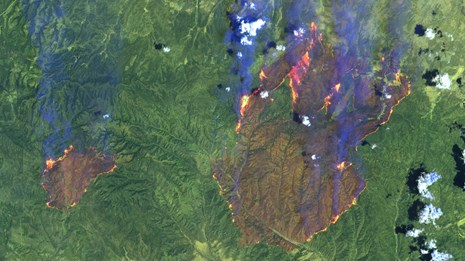 False color satellite image of wildfires burning in Arizona in 2002