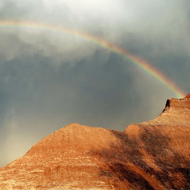 Photo of a rainbow over Badlands National Park by Shaina Niehans, NPS