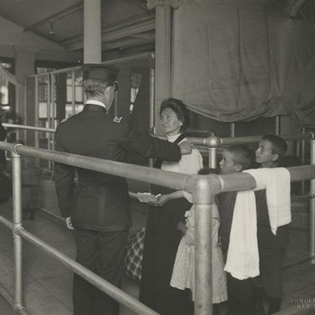 Immigrants at Ellis Island. Photo courtesy New York Public Library