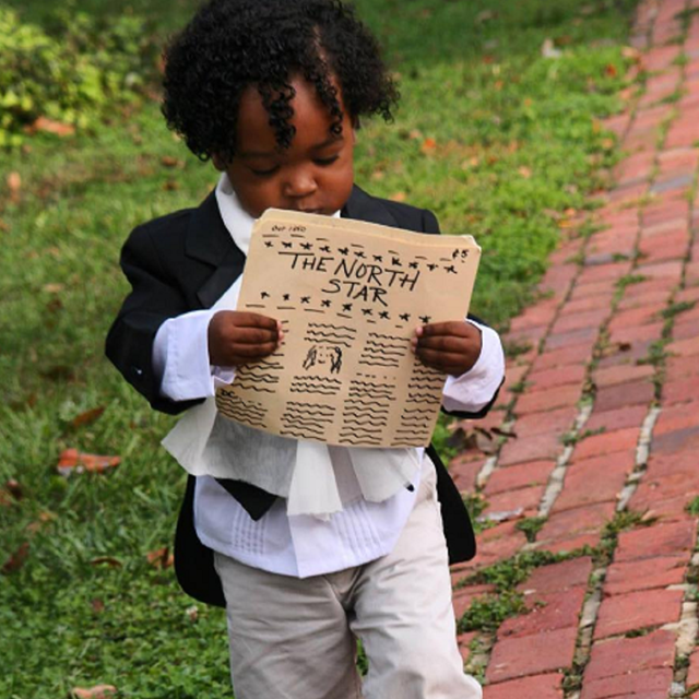 A young visitor dressed up as Frederick Douglass