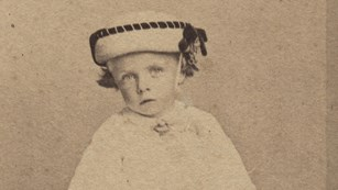 Young Theodore Roosevelt in his christening gown.