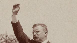 Image of TR giving a speech