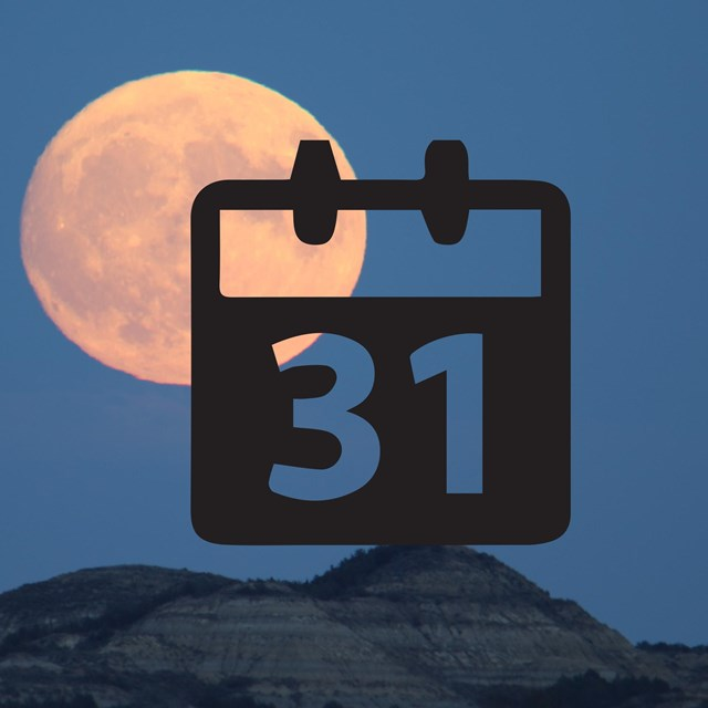 A calendar icon in front of a picture of the full moon over the badlands.