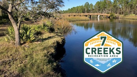 blue rive and a bridge with 7 creeks logo