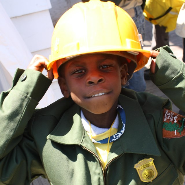 child dressing up as a ranger