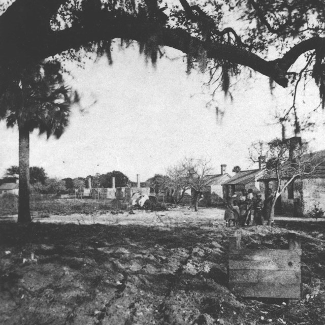 historic photo of the slave quarters at Kingsley Plantation