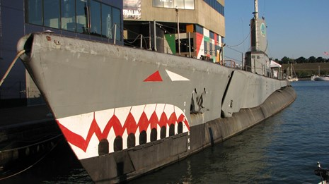USS Torsk painted as a shark docked in Baltimore's Inner Harbor.