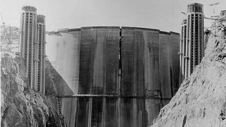 Historic black and white photo of Hoover Dam