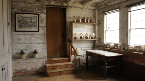 small, syrup room with whitewashed wooden walls