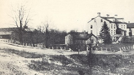 historic photo of a building in a rural setting