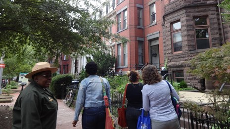 NPS ranger leading a group of women on a neighborhood tour. CC0