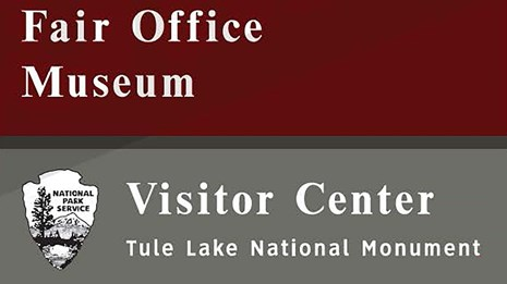 Sign with NPS arrowhead that says Fair Office, Museum, Visitor Center Tule Lake National Monument
