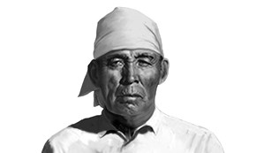 native man in white shirt and head covering