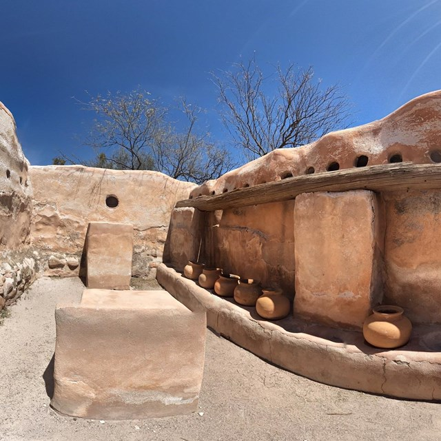 spherical panoramic photo of storeroom with pots