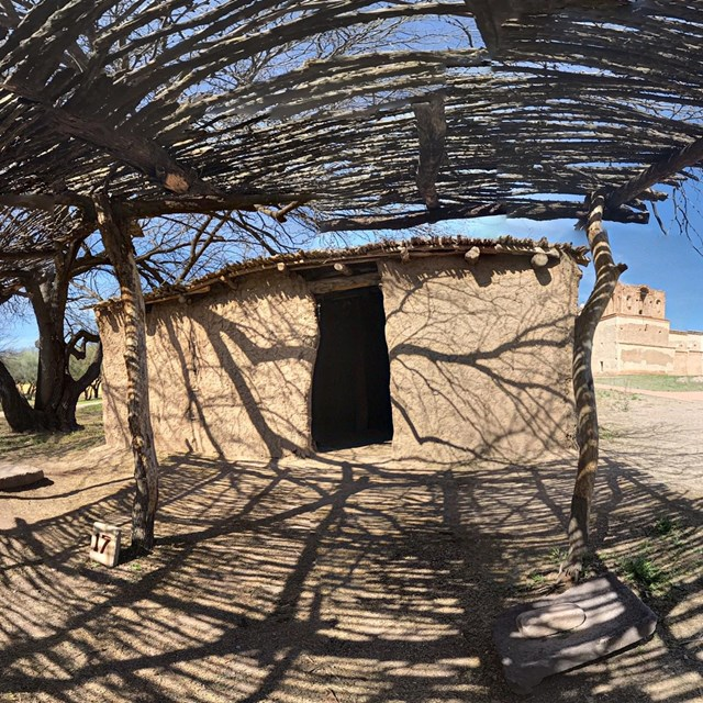spherical panoramic photo of earthen house with brush ramada
