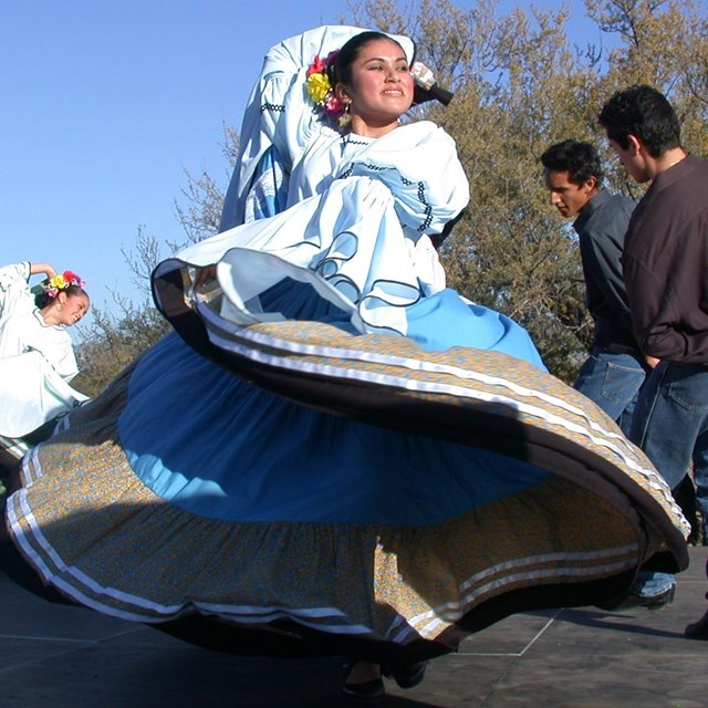 colorful folklorico dancer with large skirt