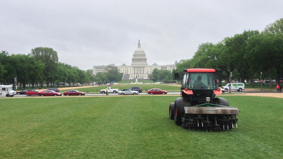 a red tractor in front of the US capitol building