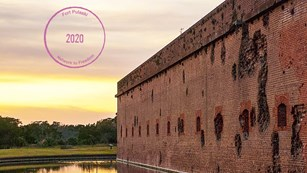 A photograph of Fort Pulaski with a Digital Passport® Stamp in the left hand corner.
