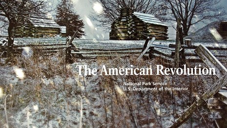 The inside cover of the American Revolution Handbook, with a photograph of snow at Valley Forge