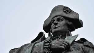 The head and shoulders of a statue of a Continental Army General.