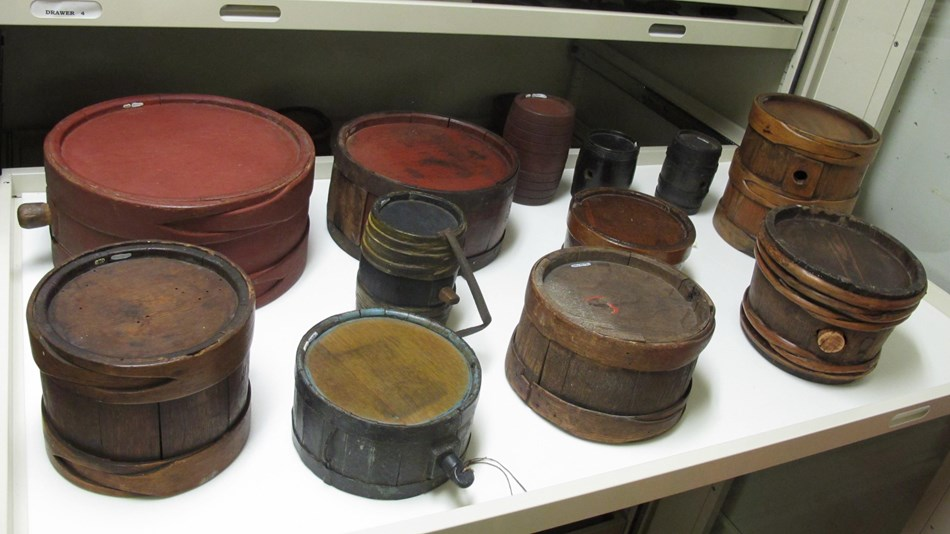 Collection of 18th century wooden drum canteens.