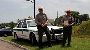 rangers in front of a patrol car