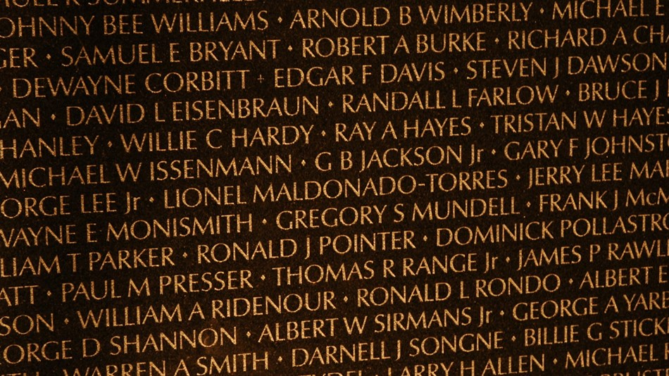 Names on the Vietnam Veterans Memorial wall.